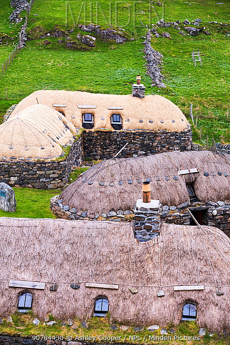 The Black House village at Garenin near Carloway, Isle of Lewis, Outer Hebrides, Scotland, UK. June 2015.  These ancient traditional houses have been preserved, after they were abandoned finally in the 1970s.