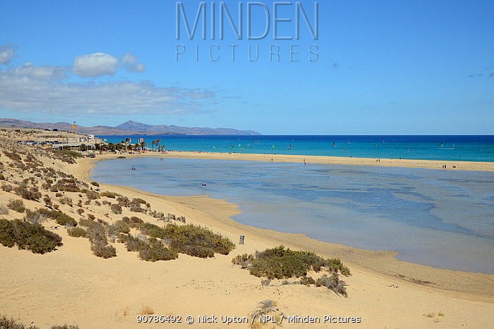Sotavento lagoon, looking towards the Windsurf Centre and windsurfers, near Jandia, Fuerteventura, Canary Isalnds, May.
