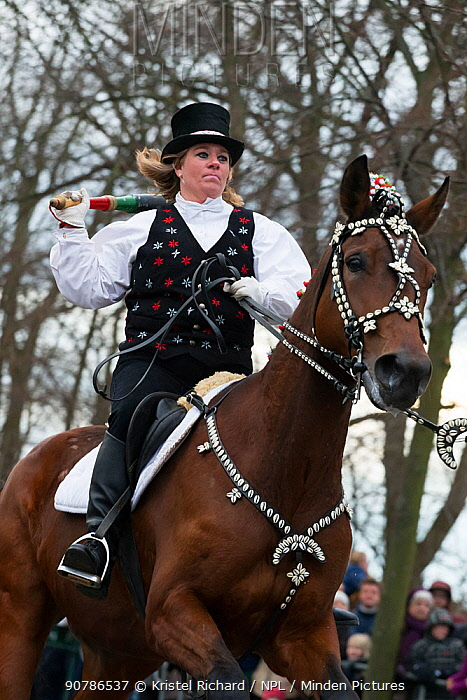 Costumed rider participating in Tondeslagning, in the streets of Store Magleby, Denmark. Tondeslagning is an ancient tradition to bring good crops by smashing a barrel which is supposed to contain the devil. February 2016.