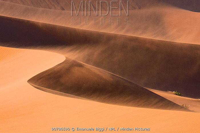 Sand dunes moving in the wind, Sossusvlei,  Namib-Naukluft National Park, Namibia