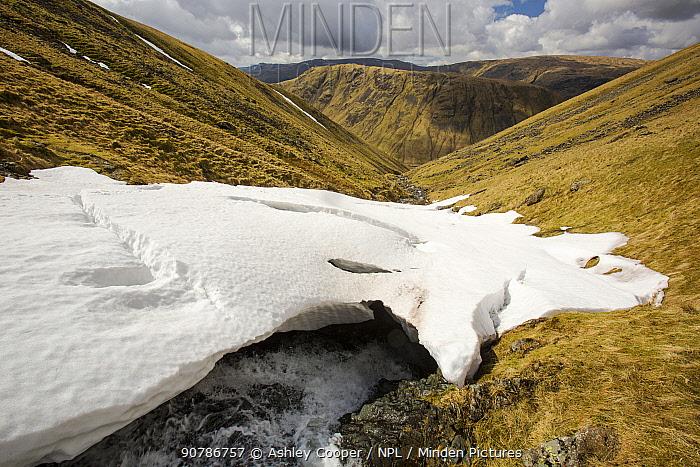 Raise Beck above Dunmail Raise, with large snow drift, Lake District, England, UK, April.