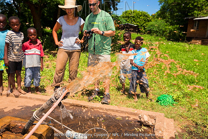 Medecins sans Frontieres  volunteer,  Makhanga pumping out a ground water drinking well that has been contaminated by polluted flood water after the January 2015 floods. Malawi, March 2015.