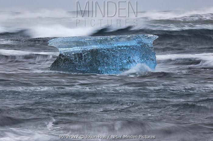 Iceberg in strong waves, Jokulsarlon, southern Iceland, February 2015