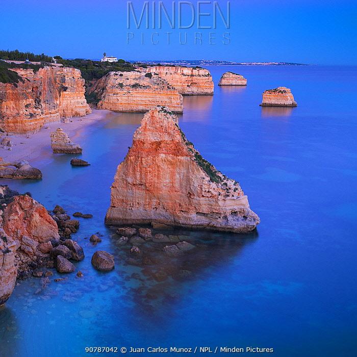 Coastal rock formations at Praia da Marinha, Algarve, Portugal, Atlantic Ocean, January.