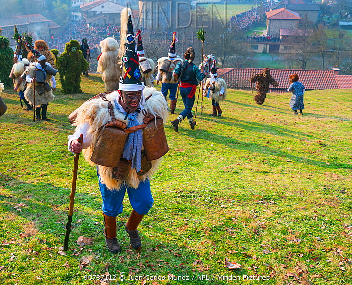 Man in traditional  Zarramaco 'warrior of good' costume,'La Vijanera Carnival, Silio, Cantabria, Spain. January.