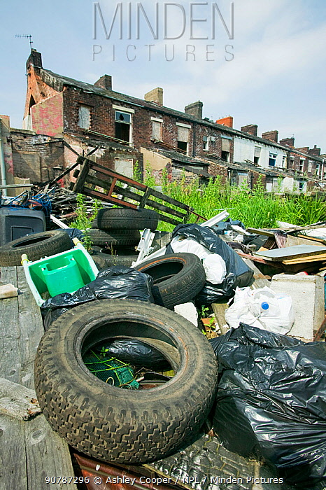 Illegal fly tipping in a rundown area of Blackburn, England, UK. June 2006