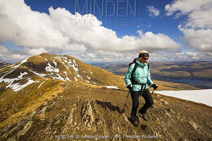 Hill walker on Ben Lawers above Loch Tay in the Scottish Highlands, UK, Scotland. April 2014