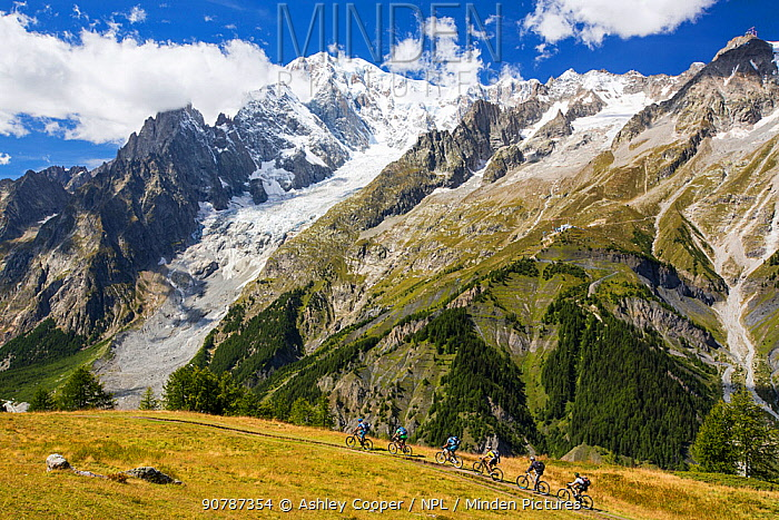 Rapidly receding Brenva Glacier in the Mont Blanc range, Italy, with cyclists. August 2014