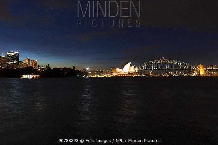 Sydney harbour at night witht the Sydney Opera House and Sydney Harbour Bridge, Australia.