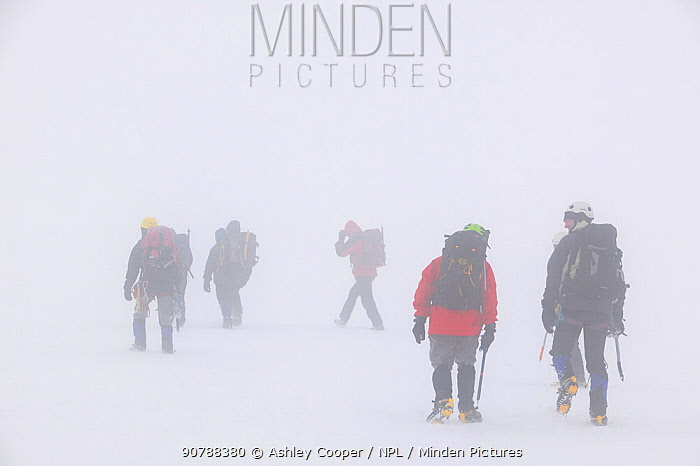 Climbers in a whiteout on Aonach Mhor a Munro near Fort William Scotland. March 2005