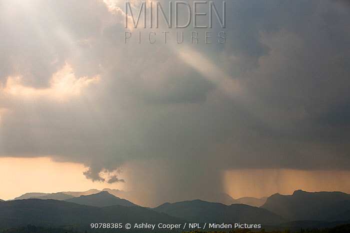 Thunder storm passing over the Langdale Pikes, Lake District, England, UK. May 2012