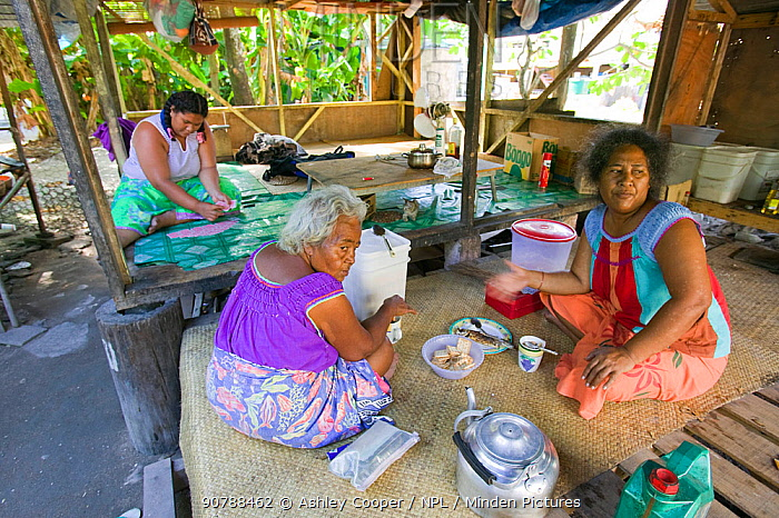 Tuvaluan family having breakfast on Funafuti atol Tuvalu. March 2007