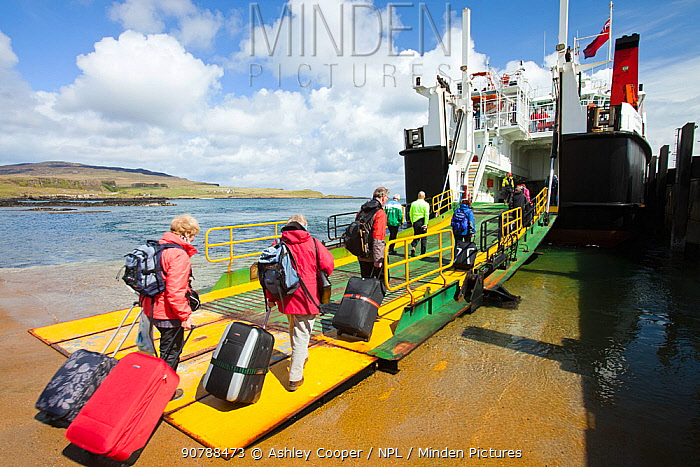 Foot passengers embark the Caledonian Macbrayne ferry, Loch Nevis, which services the Isle of Eigg from Mallaig, Scotland, UK.. May 2012
