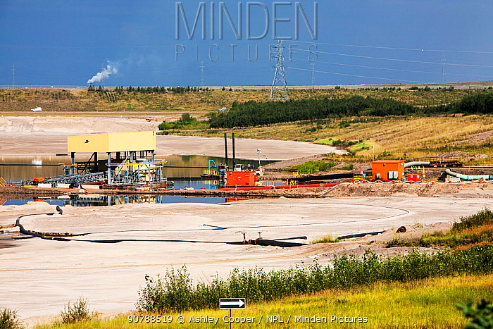 Tailings pond at the Syncrude mine north of Fort McMurray, Alberta, Canada. Tailings ponds in the tar sands are unlined and leach toxic chemicals into the surrounding environment.  August 2012