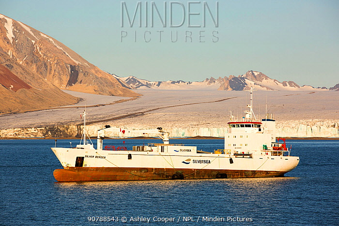 Glacier at Recherchefjorden on Western Svalbard with a mine supply ship. Svalbard, Norway. July 2013