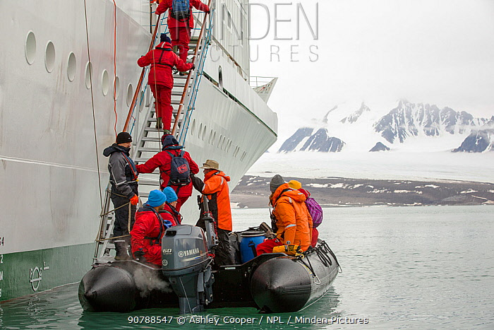 Passengers disembark Zodiaks onto the Russian research vessel, AkademiK Sergey Vavilov an ice strengthened ship on an expedition cruise to Northern Svalbard in front of a glacier. July 2013
