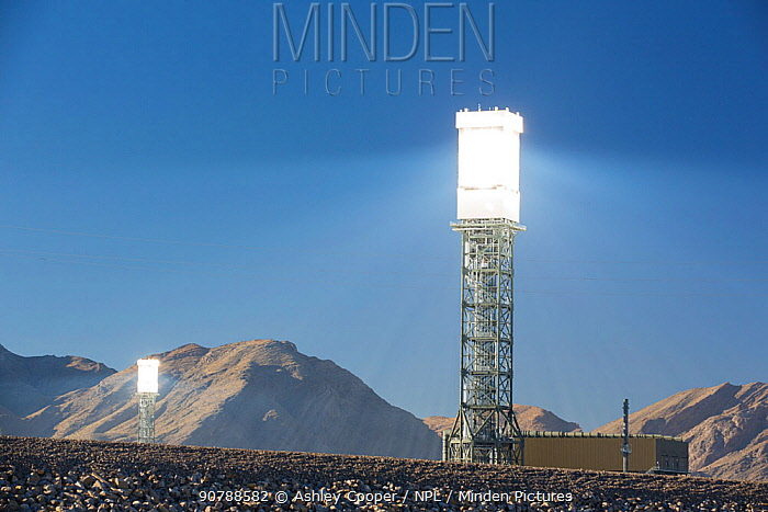 Sun rays reflected onto solar tower at Ivanpah Solar Thermal Power Plant,  the largest solar thermal plant in the world. It covers 4,000 acres of desert and produce 392 megawatts (MW) of electricity. Mojave Desert, California, USA. September 2014.