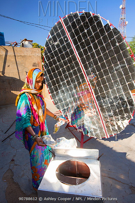 Women constructing solar cookers at the Barefoot College in Tilonia, Rajasthan, India. The Barefoot College is a worldwide charity, founded by Bunker Roy, its aims are, education, drinking water, electrification through solar power, skill development, health, women empowerment and the upliftment of rural people. December 2013