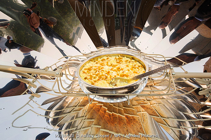 A solar cooker being used to cook food at the offices of WWF India, in Delhi, India. December 2013