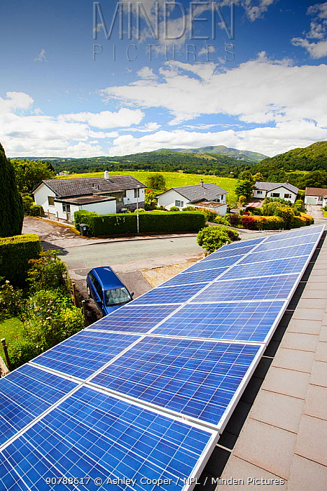 Solar PV panels on a house roof in Ambleside, Lake District, UK. July 2012