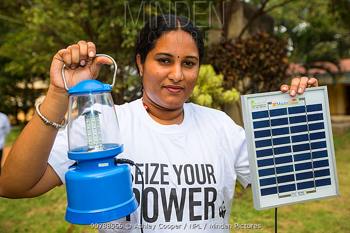 Solar lantern powered by a solar panel, part of a display to promote renewable energy in Karnataka, India. December 2013