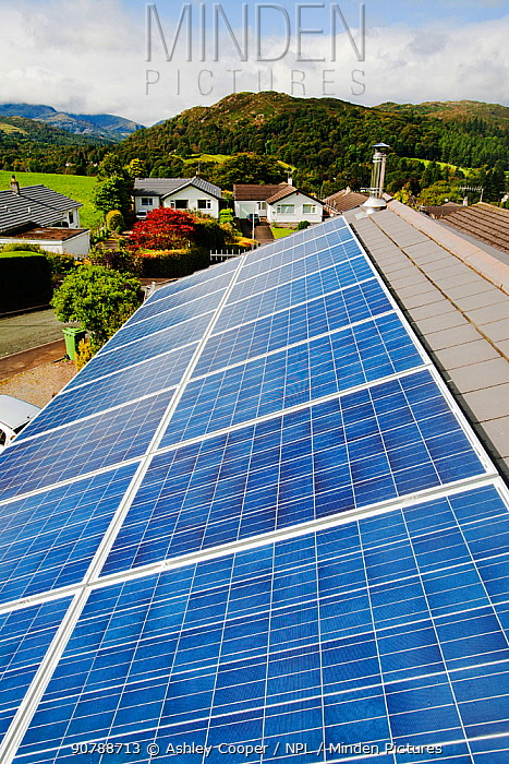 Solar voltaic panels on a house roof in Ambleside, Cumbria, UK. September 2011