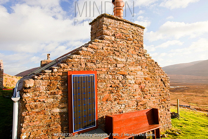 An old croft house with a solar panel at Rackwick on the isle of Hoy, Orkney, Scotland, UK. October 2011
