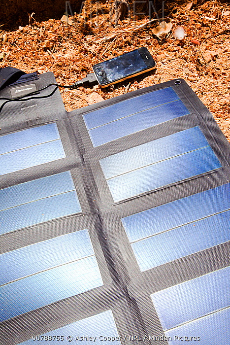 A portable solar mat used fro recharging a mobile phone in the Anti Atlas mountains of Morocco, North Africa. April 2012