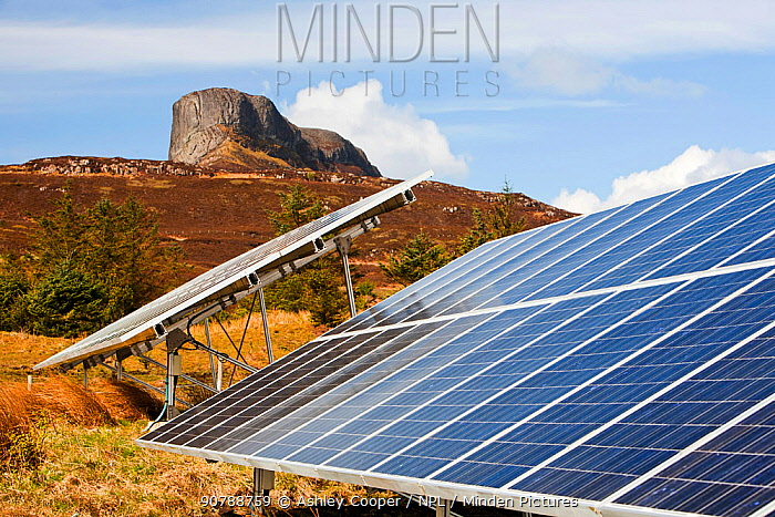 Solar panels on the Isle of Eigg which relies exclusively on renewable energy. Scotland, UK. May 2012