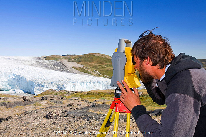 Scientist taking measurements as part of a study to measure the speed of the Russelll Glacier near Kangerlussuag Greenland, July 2008