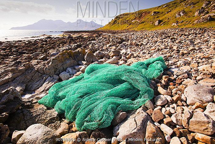 Fishing net washed up at the singing sands on the west coast of the Isle of Eigg, Scotland, UK. May 2012