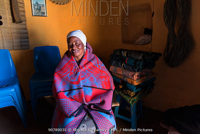 Local woman wrapped in traditional Basotho blanket in her home in Semonkong, Lesotho. August 2017
