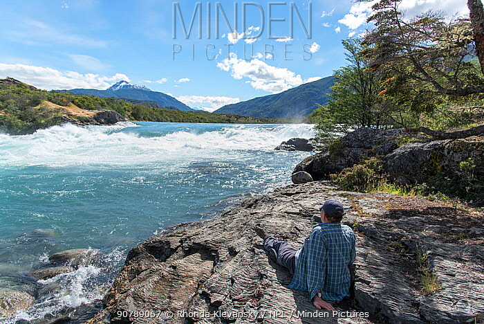 Man looking out over Baker River, Patagonia, Chile, January 2017.