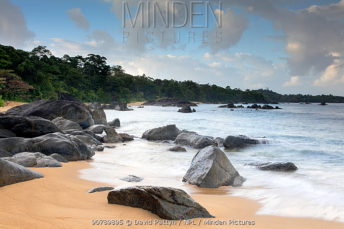 Beaches along the coast of the Bay of Angotil. Scattered eroded rocks and fringed with primary rainforest. Masoala National Park, North eastern Madagascar. August