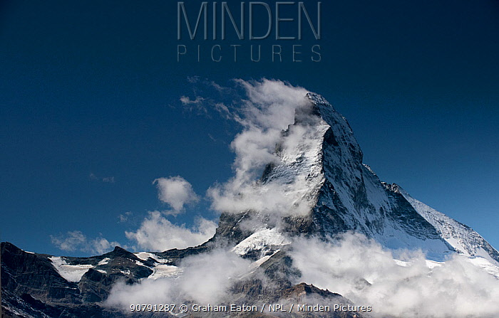 Sail clouds developing behind the lee side of the Matterhorn in the afternoon, Zermatt, Switzerland, September