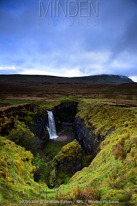 Hull Pot, Horton in Ribblesdale, Yorkshire, England, UK, January. Hull Pot is a collapsed cave in Carboniferous age limestone. In wet conditions a stream flows into the pot and continues its journey in an underground cave system.