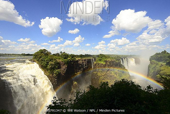Victoria Falls/ Mosi-oa-Tunya  with rainbow and dense mist, Main Falls, UNESCO World Heritage Site,  Zimbabwe. January 2018.