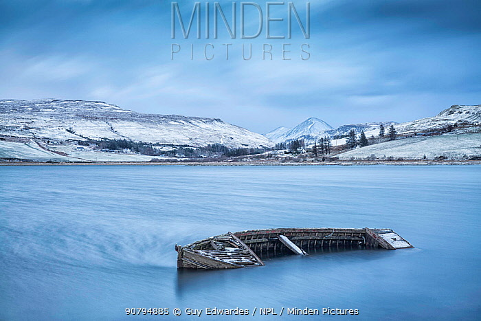 Boat wreck in Loch Harport, Carbost, Isle of Skye, Inner Hebrides, Scotland, UK. January 2015.