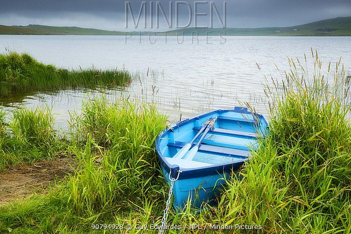 Boat at edge of Loch of Spiggie, Shetland, Shetland Isles, Scotland, UK. July 2014.