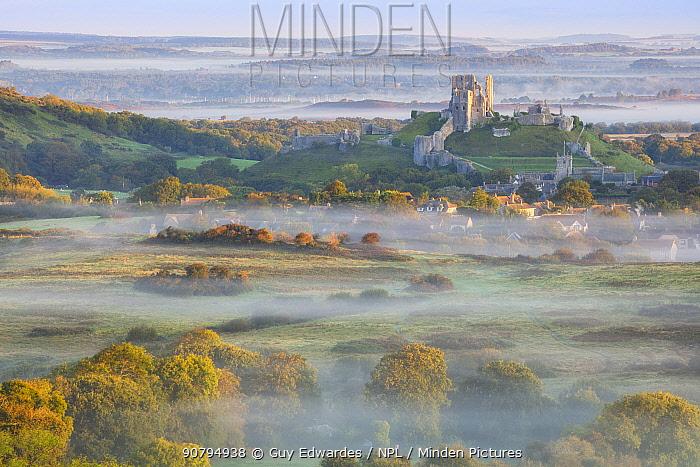 Corfe Castle in morning mist, Corfe, Isle of Purbeck, Dorset, England, UK. September 2017.