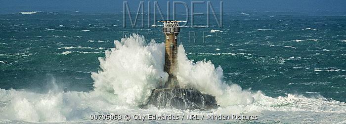 Waves crashing against Longships Lighthouse, Land's End, Cornwall, England, UK. February 2015.