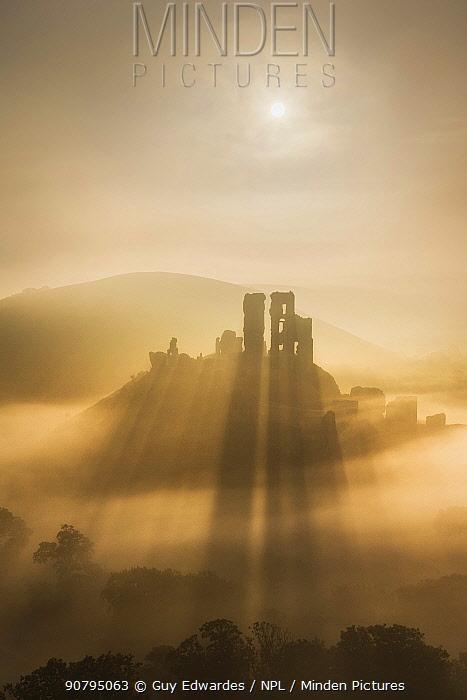 Corfe Castle in morning mist, Corfe, Isle of Purbeck, Dorset, England, UK. September 2013.