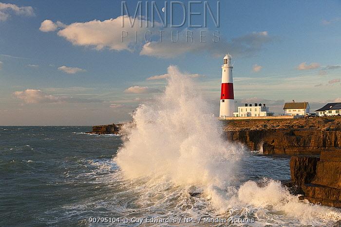 Wave breaking along coast near Portland Bill Lighthouse, Isle of Portland, Dorset, England, UK. January 2012.