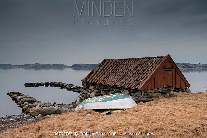 A distinctive boatshed on the shores of Hafrsfjord, Stavanger, Norway, March