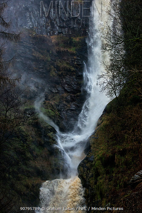 An updraft (vortex) of spiralling air and moisture caused by air being displaced by falling water. Pistyll Rhaeadr waterfall, located a few miles from the village of Llanrhaeadr-ym-Mochnant in Powys, Wales, UK, April