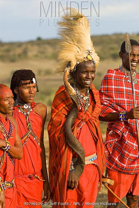 Maasai, young warriors, one with lion mane head dress. Maasai Village, Kenya. September 2006.