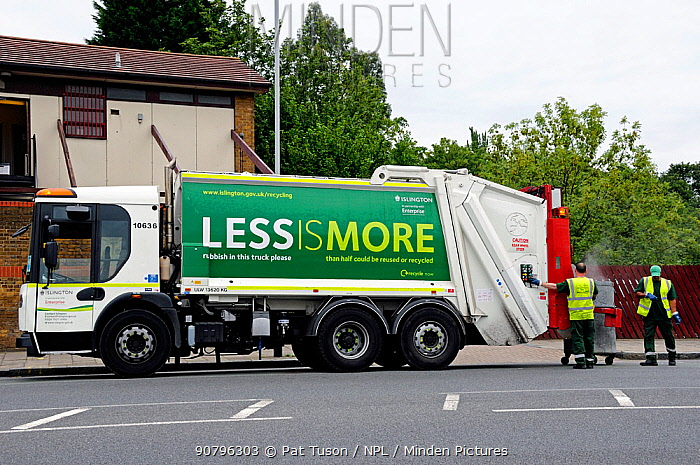 Waste Truck with recycling slogan on the side, working at the rear Highbury, London Borough of Islington, UK