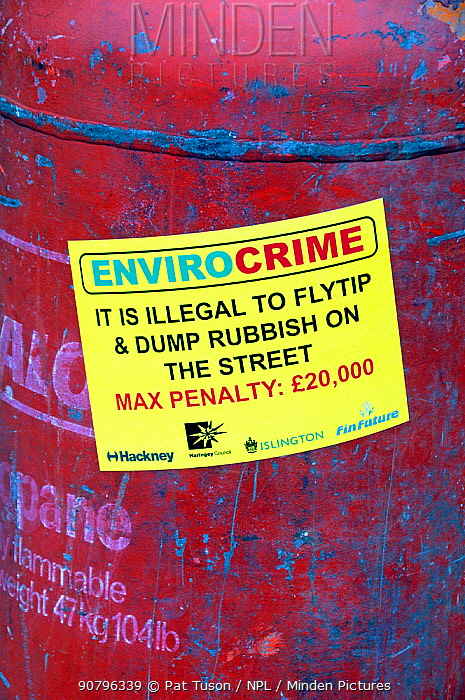 Envirocrime label stuck onto a cylinder with inflammable contents dumped in street London Borough of Islington, UK