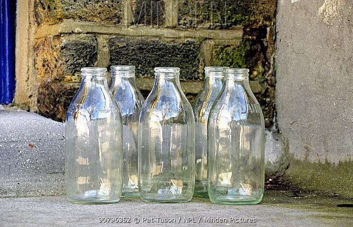 Five empty glass milk bottles on doorstep, Highbury, London Borough of Islington England UK