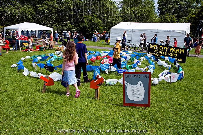 Children in old plastic bag maze made from recycled plactic bags, Camden Green Fair, England, UK, June 2006